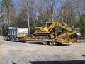 Dump truck trailer excavator